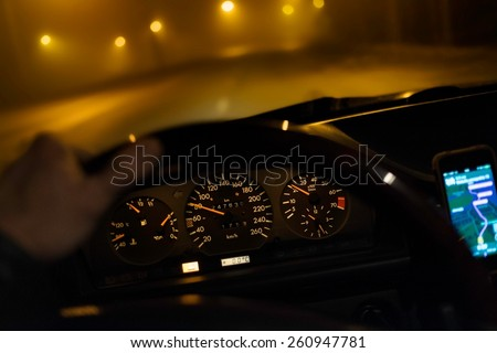 Driving car during low visibility at night - stock photo