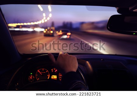 Driving car during sunrise - stock photo