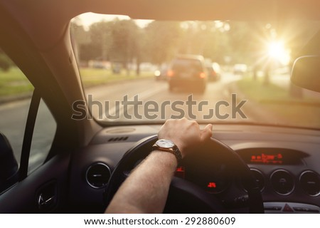Driving down the street in car on a sunny beautiful day - stock photo