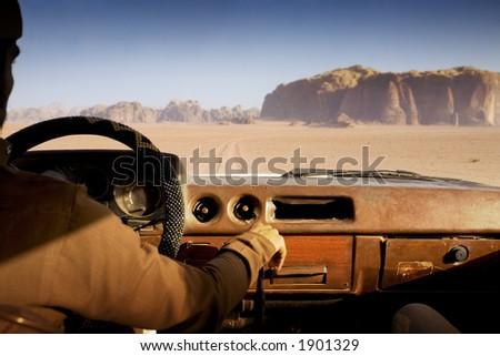 driving fast in the desert - stock photo
