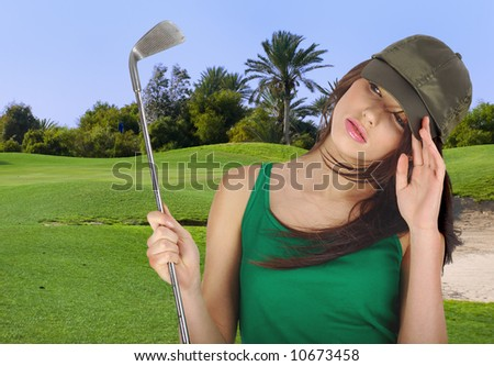Driving golf player on green background - stock photo