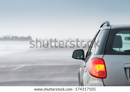 Driving in a blizzard - stock photo