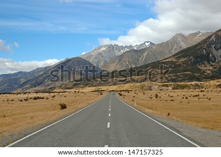 Driving in Aoraki//Mount Cook National Park, South Island, New Zealand - stock photo