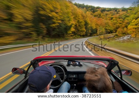 Driving in convertible through fall foliage