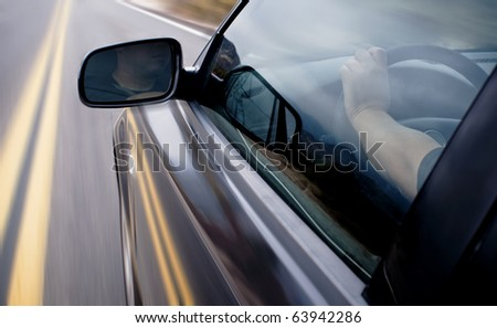 Driving in high speed with motion blur effect. - stock photo