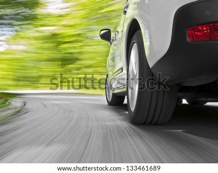 Driving in the curve - stock photo