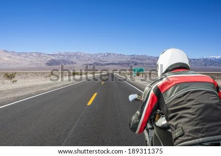 driving in the desert - stock photo