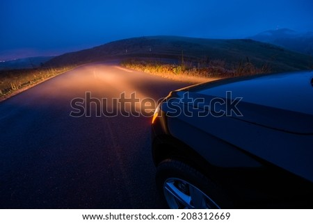 Driving in the Fog. Foggy Mountain Road Drive at Night. - stock photo
