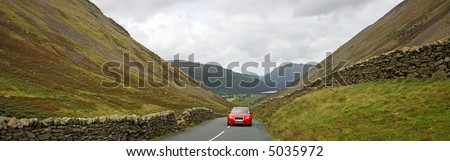 Driving in the mountains panorama - stock photo