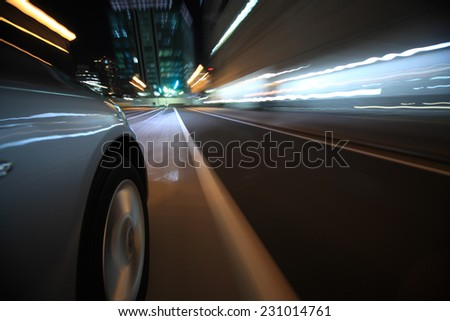 Driving in the night city - stock photo