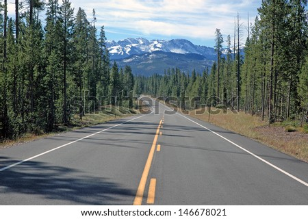 Driving in the Rocky Mountains, USA - stock photo