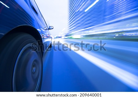 Driving in the sunset city. - stock photo