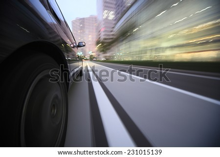 Driving in the sunset city - stock photo