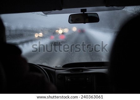 Driving in winter bad conditions - stock photo