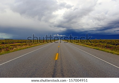 Driving into a Thunderstorm with Threatening Skies - stock photo