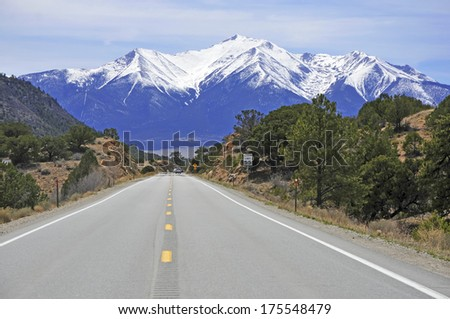 Driving into the Snow Capped Rocky Mountains, USA - stock photo