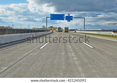 Driving on a highway with truck in front - stock photo