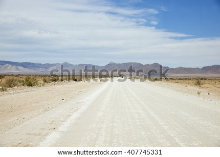 Driving on a Namibian highway, Africa - stock photo