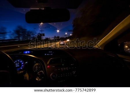 Driving on a night road highway inside car view