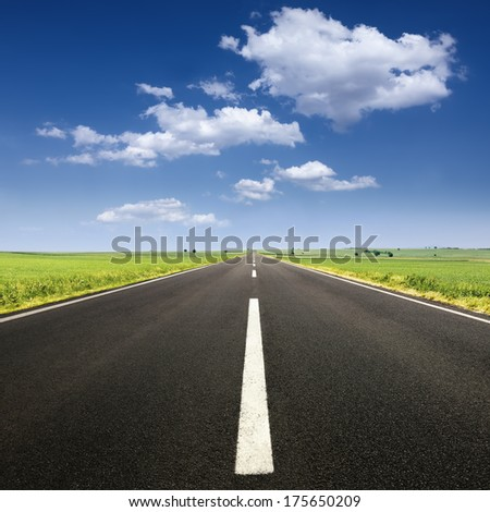 Driving on an empty road at lovely sunny day - stock photo