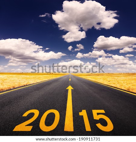 Driving on an empty road at sunny day forward to New Year - stock photo