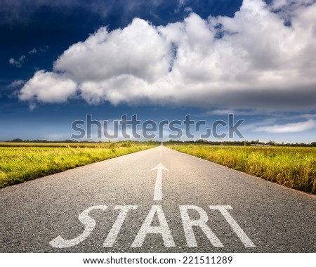 Driving on an empty road towards the big cloud with sign start on asphalt - stock photo