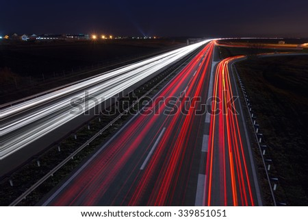 Driving on highway at night near Belgrade - Serbia. Light trails on motorway at night, long exposure abstract photograph. - stock photo
