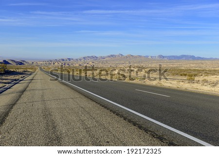 Driving on Remote Road in the Desert, Southwestern USA - stock photo