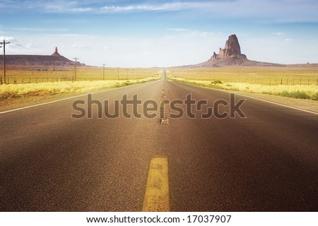 Driving on straight highway in the west of the USA - stock photo