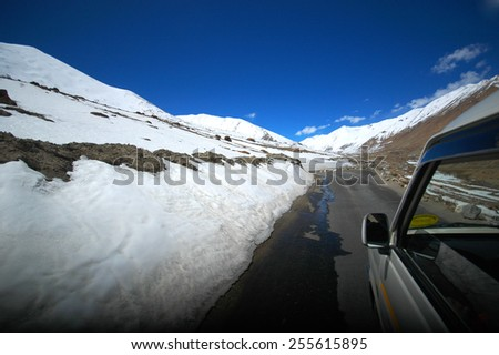 driving on the road in Himalaya range of the north of India - stock photo