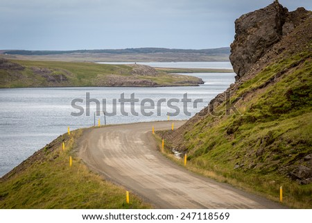 Driving on the road in the remote and wild Westfjords of Iceland  - stock photo