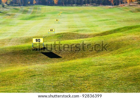 Driving range on the golf course - stock photo