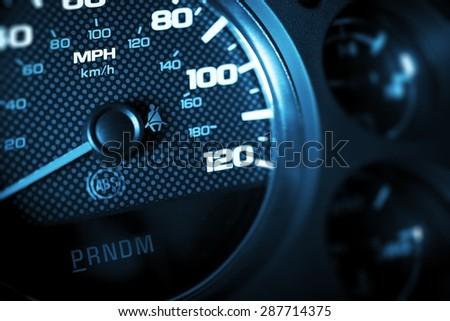 Driving Speed Control. Car Tachometer Closeup. Dark Blue Color Grading. - stock photo