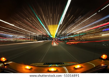 Driving the Streets of Los Angeles at Night With Lights Around. Intentional Long Exposure Drag. - stock photo