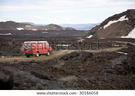 Driving through a lava field in Iceland. - stock photo