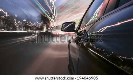 driving through Munich, during dusk, rigged camera on the side of a german black car, bulb exposure - time-lapse, special effects photography - stock photo