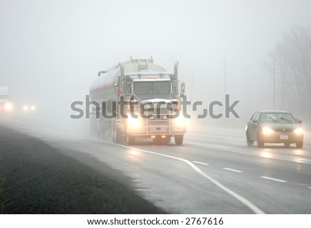 driving through the fog - stock photo