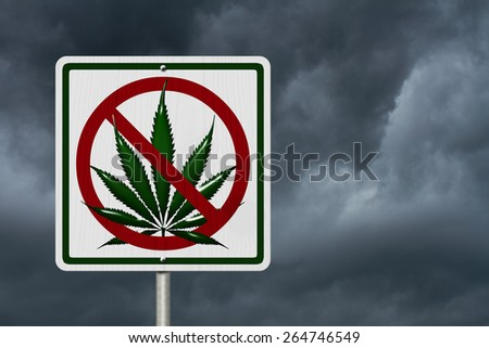 Driving Under the Influence of  Marijuana, A road highway sign with a marijuana leaf with stormy sky background - stock photo