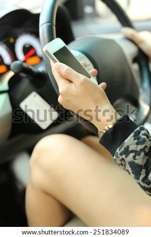Driving using cellphone is dangerous and unsafe. - stock photo