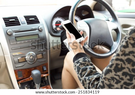 Driving using cellphone is dangerous and unsafe - stock photo