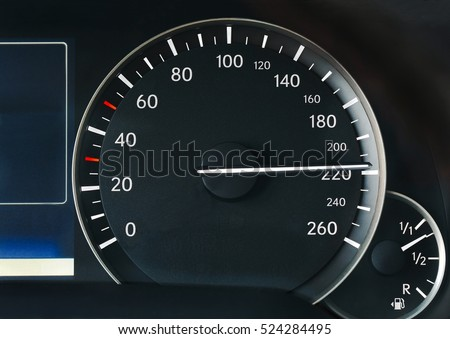 Driving very fast, speedometer showing 210