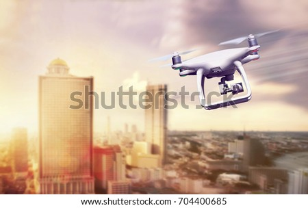 Drone fly on time beautiful Sun set  on the Modern city  Mount high quality camera Modern technology