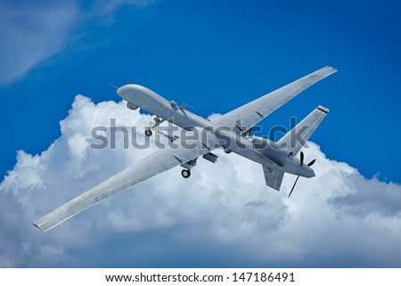 Drone flying in the clouds top view - stock photo