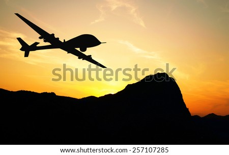Drone flying over mountains on sunset background. Illustration - stock photo
