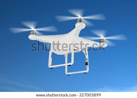 Drone, quadrocopter, in the blue sky. - stock photo