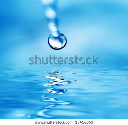 Drop falling in water - stock photo