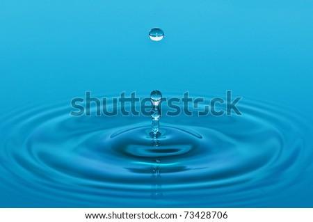 drop in blue water closeup - stock photo