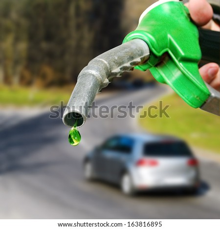 Drop of green fuel. - stock photo