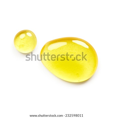 Drop of honey isolated on white background - stock photo