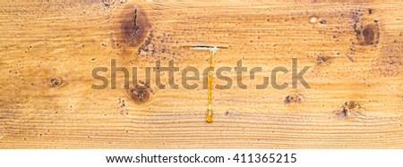 Drop of Resin on brown wood background - stock photo